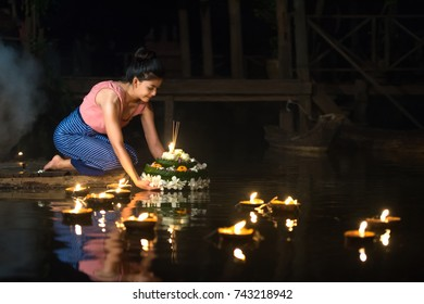 Thai woman wear culture costume praying in Loy Krathong fastival of Thailanad.
