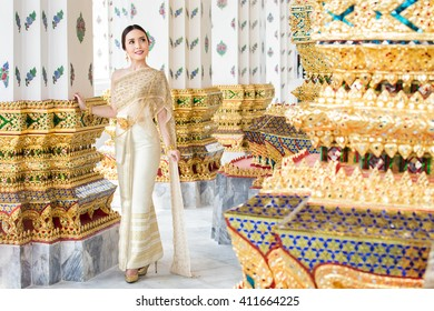 Thai woman wearing Thai traditional bridal dresses (Thai Chakri). Dress of Thai silk and metal thread brocade with Bead and sequin embroidery.