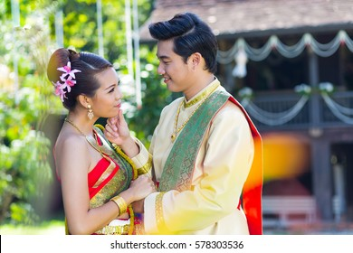Thai women and Men with traditional Thai suit. wedding dress. Beauty Fashion Hairstyle Makeup photo shoot Wedding.