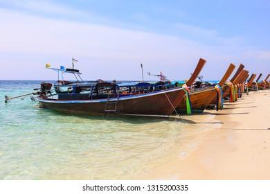 Thai wooden boat on sea beach at Lipe island, Satun province, Thailand