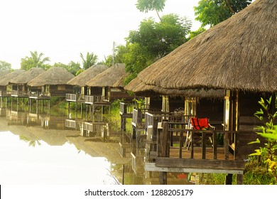 THAI wooden Cottage thatch roofing on water