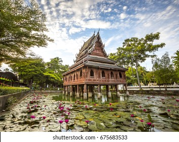 Thai wooden temple architecture on the lotus pond at wat Thung Si Muang in Ubon Ratchathani province, Thailand