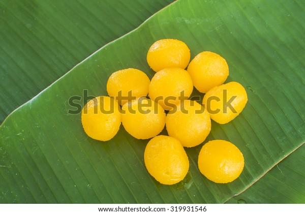 Thai yellow dessert on banana leaf