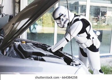 THAILAND  -16 JUNE - , a man wearing Stormtrooper repairing an old car at Pattaya, Thailand on June 16, 2017
