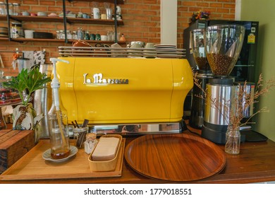 Thailand : 19 Feb 2020 cozy interior shot of cafe in Thailand with coffee grinder and yellow coffee machine.
