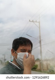 In Thailand 2019, men wear a mask to prevent dust, pollution, smog, Dust particles of no more than 2.5 microns PM2.5