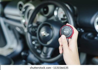 Thailand :26 June 2016, Woman holding remote control key in Mini Cooper car.