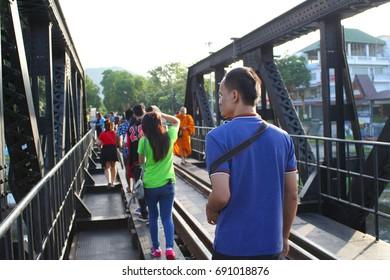 "THAILAND; 29 JULY 2017; the tourists walking on the bridge, ""the BRIDGE RIVER KWAI"" sights of Kanchanaburi."