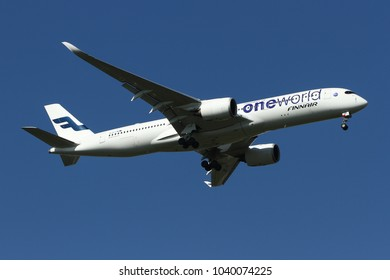 THAILAND, 31 DEC 17: Airbus A350-900 XWB (OH-LWB) of Finnair (Oneworld member) as seen landing at Bangkok Suvarnabhumi Airport from Helsinki, Finland on a beautiful bright sunny day with blue sky.
