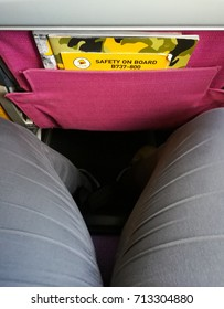 THAILAND, 9 SEP 17: Nokair, Boeing 737-800 (HS-DBA) aircraft seat viewed as a passenger perspective from the rear with details of seat pitch and safety instruction leaflet. Illustrative editorial.