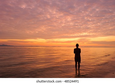 Thailand. Andaman sea. Phi Phi island. Magic sunrise landscape and a silhouette of alone girl