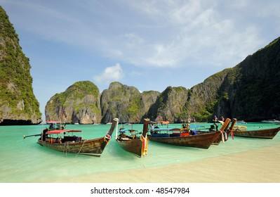 Thailand. Andaman sea. Phi Phi island. Thai boats on Maya bay lagoon
