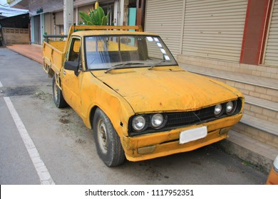 THAILAND APRIL 12;Old yellow truck from heavy use parked in the street on April 12,2018 in Thailand.