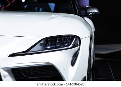 Thailand - April , 2019 : close up headlight front view of Toyota Supra GR sports car presented in motor show Thailand .