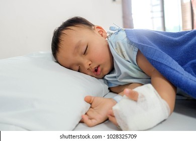 thailand asian little boy baby in hospital bed.