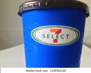 Thailand - August 3, 2018: Blue paper cup of 7-Select iced beverage by 7-Eleven