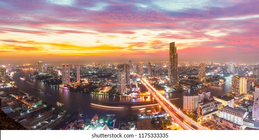 Thailand Bangkok city skyline.Scenic cityscape of Bangkok with dramatic sky before sunset with modern skyscraper and Chao Phraya river in background.