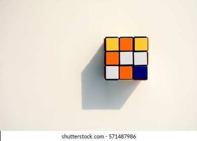 thailand, bangkok. february 4, 2017. Rubik's cube with shadow on the white background. - Rubik's Cube invented by a Hungarian architect Erno Rubik in 1974.