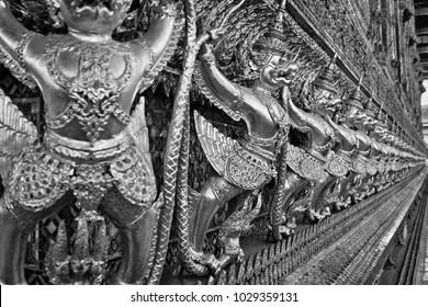 Thailand, Bangkok, Imperial Palace, Imperial city, golden ornamental statues on the wall of a Buddhist temple