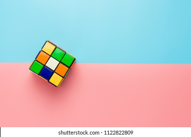 Thailand, Bangkok. June 29, 2018. Rubik's cube on pink and blue background. - Rubik's Cube invented by a Hungarian architect Erno Rubik in 1974.