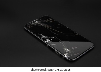 Thailand, Bangkok - june 7- 2020: iPhone XR Broken glass on a black background, equipment must be repaired