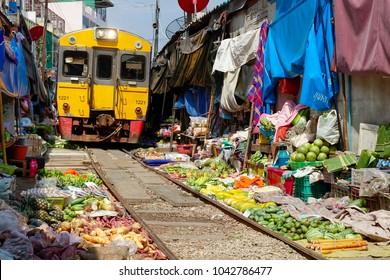 Thailand, Bangkok. Maeklong railroad tracks market (Train Market)