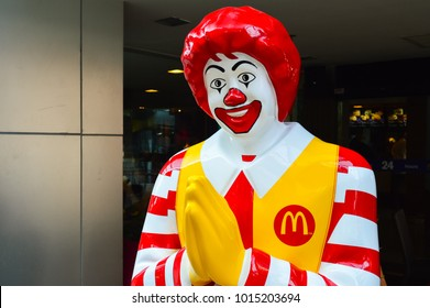 Thailand, Bangkok, March 02, 2013: Ronald McDonald Asian type of character near entryway to McDonalds restaurant in Bangkok, Thailand. Ronald McDonald is the main mascot of the McDonald's restaurants.