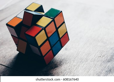Thailand, bangkok. March 25, 2017. Rubik's cube on wooden background. Rubik's Cube invented by a Hungarian architect Erno Rubik in 1974.