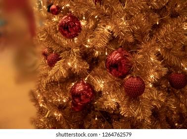 Thailand, Bangkok - November 2018: gold christmas tree with red decoration
