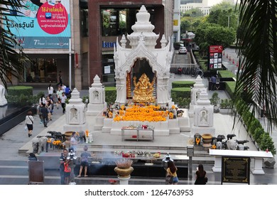 Thailand, Bangkok - November 2018: People visiting Ganesh Shrine to pray
