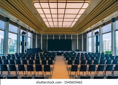 Thailand, Bangkok – September 2019: Business Hall Conference Room. Empty Presentation Hall Interior with Screen, Stage, and Chairs. Conference or Seminar Large and Luxury Meeting Room.