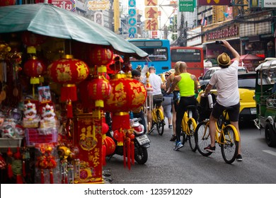 Thailand : Bangkok, Thursday 15 November 2018, Tourists cycling and enjoy take photo by cell phone in China town or Yaowarat road