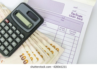 Thailand banknotes, calculator and cash sale