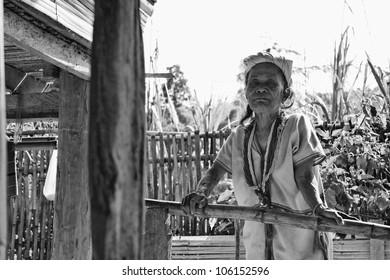 Thailand, Chiang Mai, Karen Long Neck hill tribe village (Kayan Lahwi), a Karen woman in traditional costumes