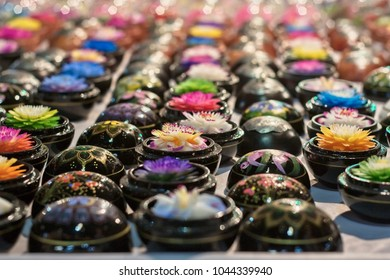 Thailand, Chiang Mai, soaps hand crafted with various flowers shapes for sale in a local market