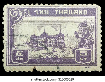 "THAILAND - CIRCA 1940: Old Stamp Features Chakri Maha Prasat Throne Hall The Paper Used a Coarse Paper Made From Bamboo, Thailand. The Series ""Chakri Maha Prasat Throne Hall"", Thailand, Circa 1940."