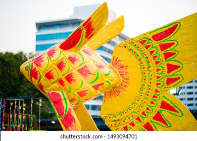 Thailand , Colorful of weave fish made from weaving leaves handicraft and hanging as moving for traditional old style Thai home interior decoration. Mobile toy for baby. Selective focus.