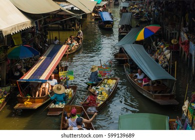 THAILAND DAMNOEN SADUAK - March 20, 2016 : Damnoen Saduak Floating Market Featuring many small boats laden with colourful fruits, Tourist attraction vegetables and Thai cuisine
