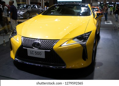 Thailand - Dec , 2018 : close up front view of Lexus LC 500 yellow color sports car presented in motor expo Nonthaburi Thailand .