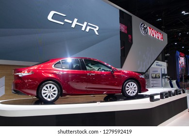 Thailand - Dec , 2018 : Toyota Camry C-HR red color sedan sports car presented in motor expo Nonthaburi Thailand .