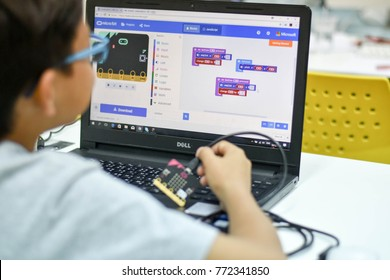 Thailand, December, 2017. The young Asian boy is coding to make his program my pets project via micro bit, the future skills for young child in the coding for kids classroom in Thailand.