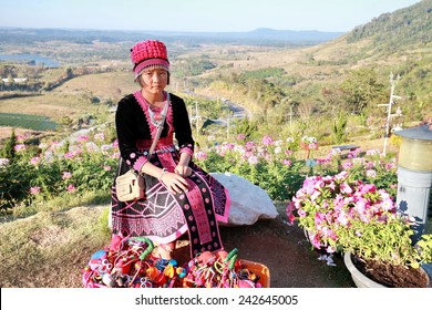 THAILAND - DECEMBER 29: The girl were dressed in tribal black and pink with silver ornaments bring gifts souvenirs sold to tourists during the festival new year, 29 December 2014  Northern Thailand.