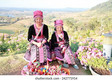 THAILAND - DECEMBER 29: The girls were dressed in tribal black and pink with silver ornaments bring gifts souvenirs sold to tourists during the festival new year, 29 December 2014  Northern Thailand