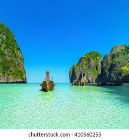 Thailand exotic beach view with traditional longtail boats against steep limestone hills after flood tide, Maya Bay, Ko Phi Phi Lee island, Phi Phi archipelago, part of Krabi Province, Andaman Sea