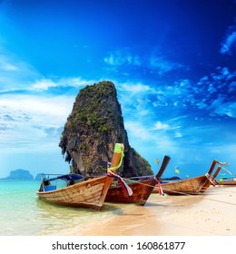 Thailand exotic sand beach and boats in asian tropical island. Beautiful tourism destination travel landscape background
