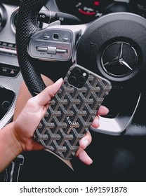 Thailand - February 15 2020: iPhone 11 Pro with Goyard Case and Mercedes-Benz Logo