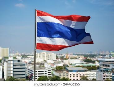 Thailand flag with blue sky on flagstaff