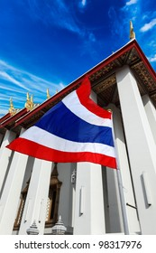 Thailand flag and Buddhist temple Wat Pho. Bangkok, Thailand