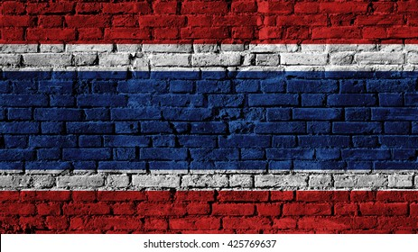 Thailand flag on a brick wall surface