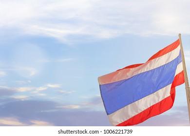 Thailand flag waving with cirrostratus cloud. Thailand flag with copy space and blue sky background.